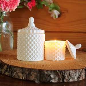 A twin set of beautiful white geo candles